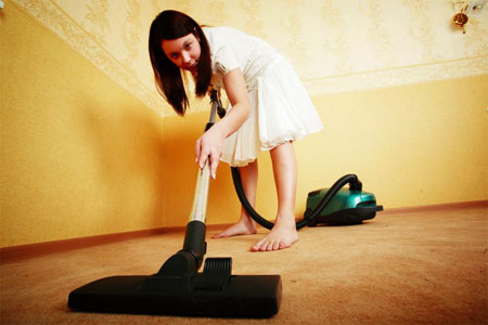 Woman Vacuuming The Carpet Stock Footage
